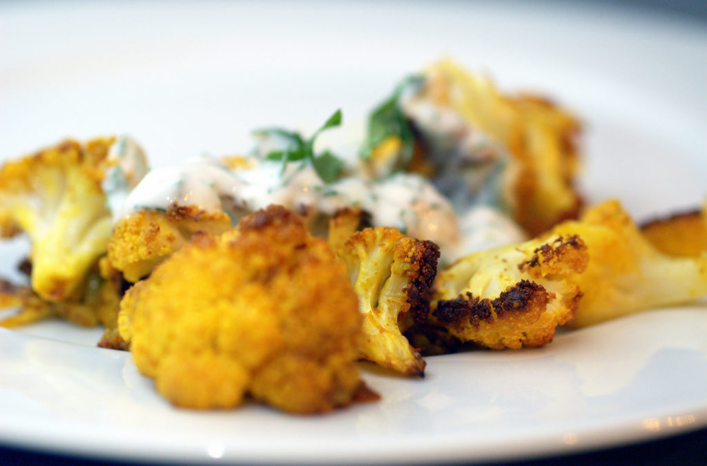 ROASTED CAULIFLOWER WITH INDIAN SPICES AND YOGURT DRESSING